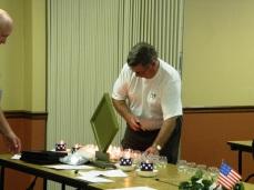 Elmer lighting a candle