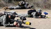 ROTC cadets take cover as they engage in paintball warfare during the anti-terror exercises