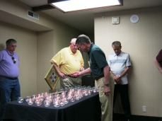 Capt. Barron lighting a candle for one of his troops