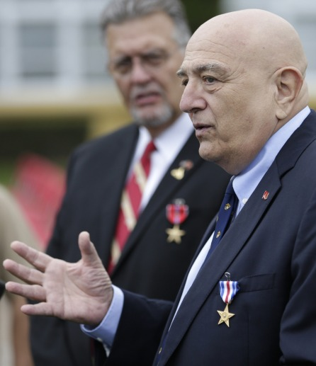 Retired Marines Joe Cordileone, right, and Robert Moffatt, left, speak during a ceremony to honor the two Vietnam War veterans at Marine Corps Recruit Depot Friday, Sept. 20, 2013, in San Diego. Cordileone was awarded the Silver Star Medal and Moffatt was awarded the Bronze Star Medal, 46 years after the two fought North Vietnamese army troops on a jungle hillside, and saw 75 percent of their unit be killed or wounded.