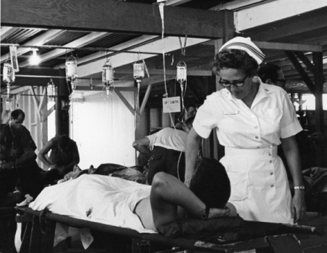 Nurse talking to wounded soldier