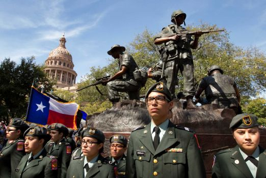 Members of the Memorial High School JROTC Minutemen Battalion from San Antonio participate in the dedication of the Texas state Capitol Vietnam Veterans Monument in Austin.