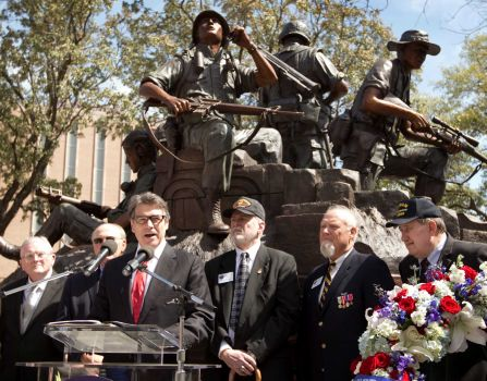 Texas Gov. Rick Perry speaks at the dedication of the Texas state Capitol Vietnam Veterans Monument in Austin, Texas, Saturday March 29, 2014. The dedication Saturday morning marks the 41st anniversary of the last U.S. troops leaving South Vietnam. About a half-million Texans served in the war, with more than 3,400 losing their lives and 105 still missing in action. (AP Photo/Austin American-Statesman, Jay Janner)
