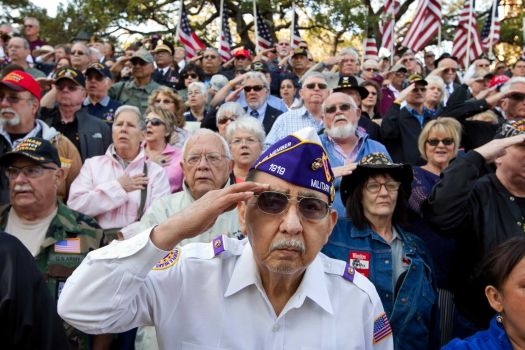Vietnam veteran Frank Cortez salutes during the national anthem at Saturday's the dedication of the Texas state Capitol Vietnam Veterans Monument in Austin.
