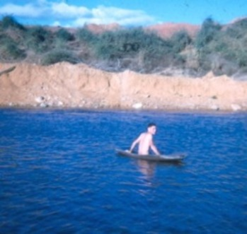 Tom on a raft in the river