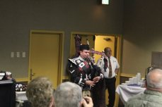 After the remembrance ceremony Nathan the bagpiper played Amazing Grace. Courtesy of Charlie.